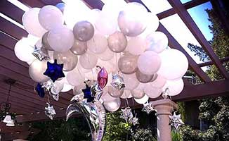 Giant cloud ceiling decoration with white, clear and silver balloons